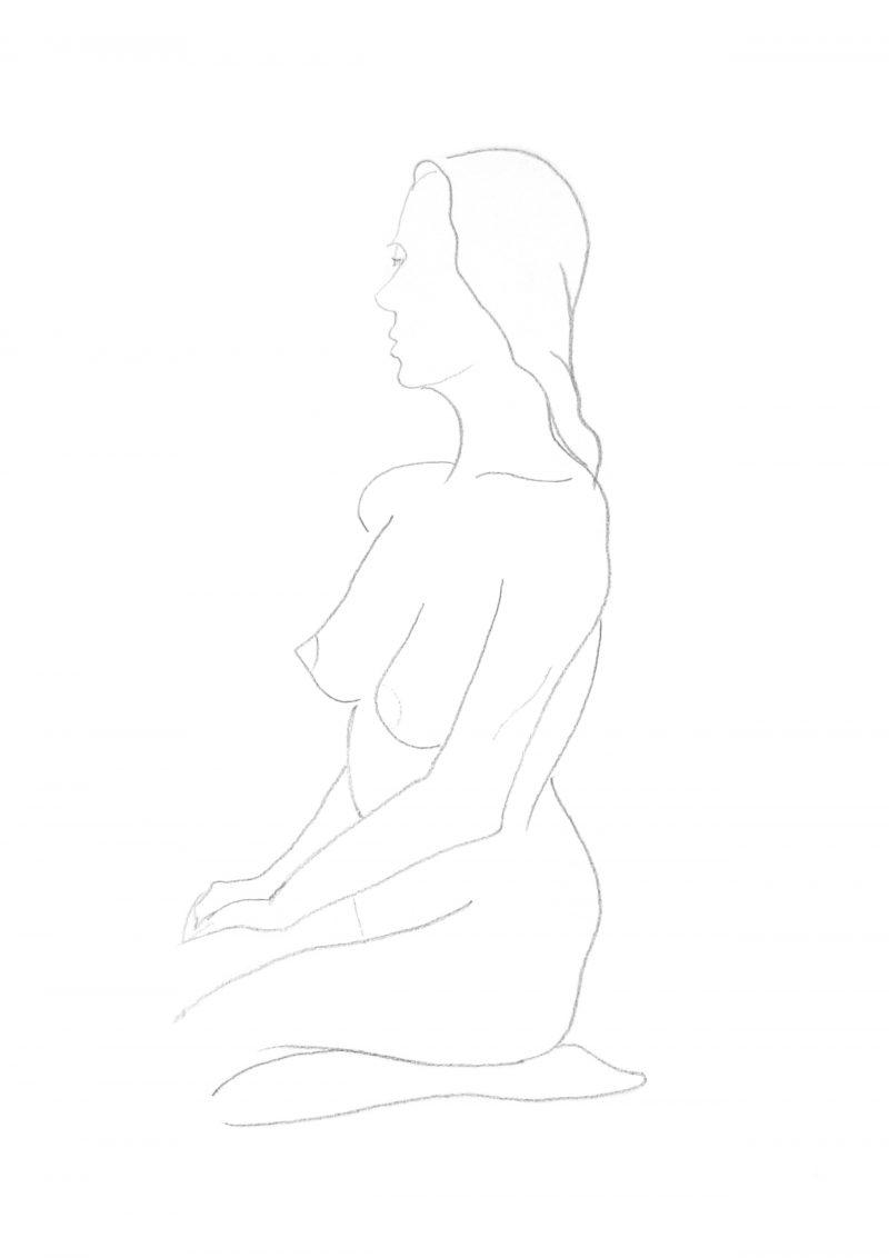Woman seated on heels